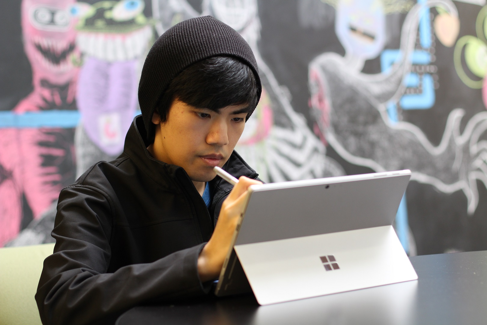 Marvin's holding a Surface pen in front of his Surface