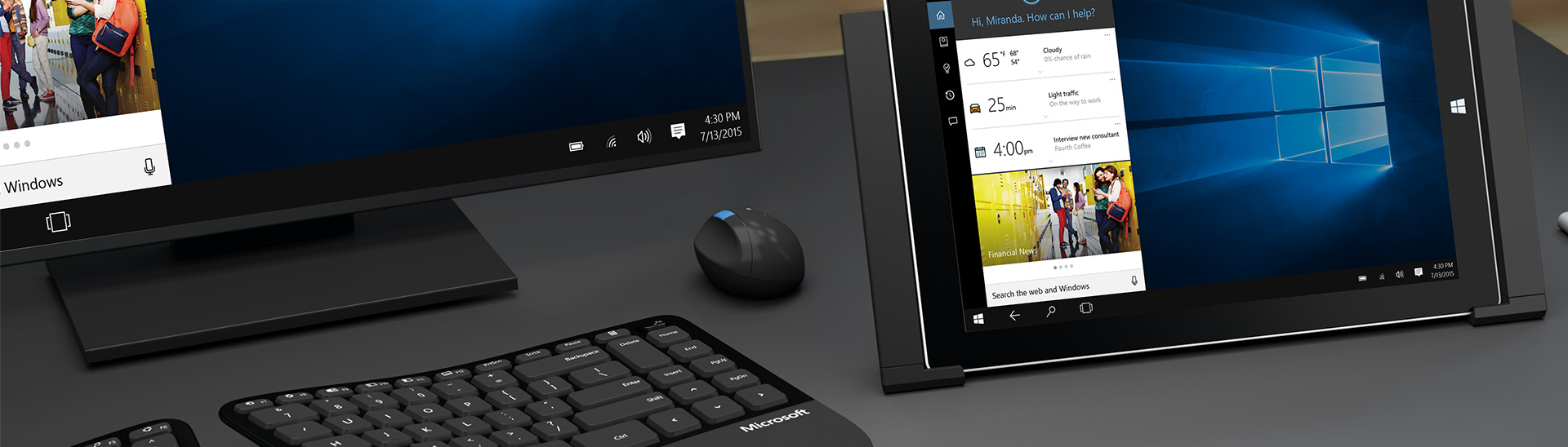 Microsoft Surface in a Surface dock with a wireless keyboard and mouse in front of a monitor.