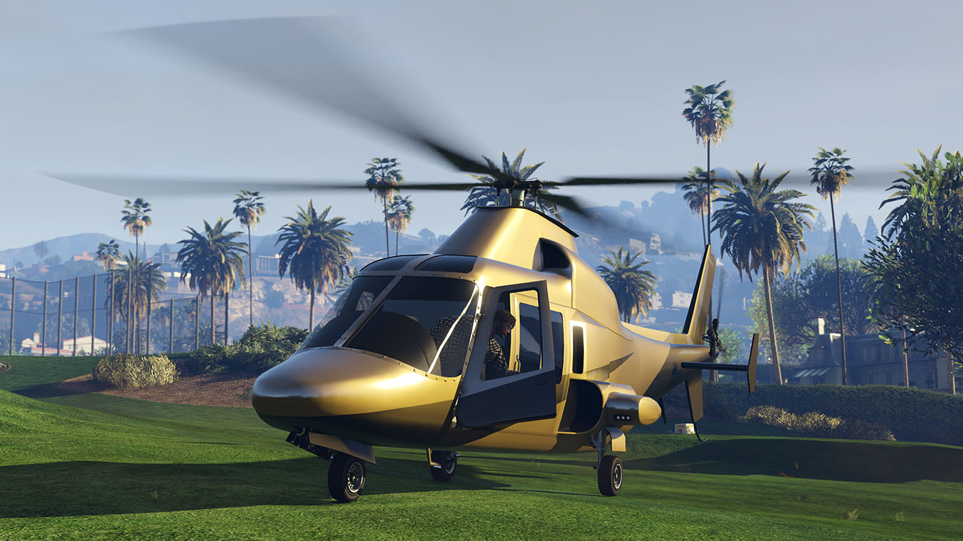 Gold helicopter idles on a golf course