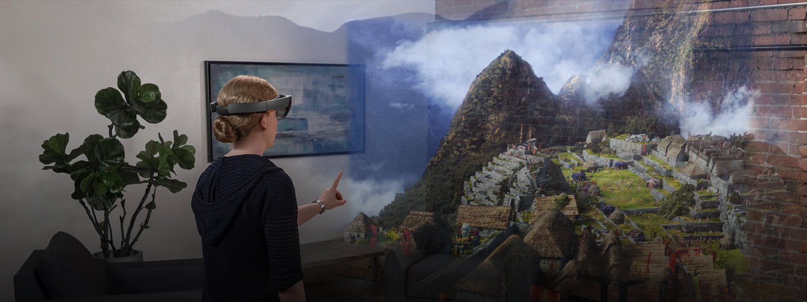 Woman wearing HoloLens looking at holographic scenery with ancient structures built on a misty mountainside