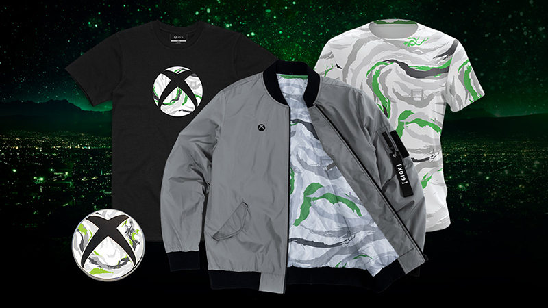 A collection of Xbox Gear, including two shirts and a jacket. They all feature elements from the unique X019 Aquabrush print. The image also shows the unique X019 Xbox Nexus, which also features the custom Aquabrush prin
