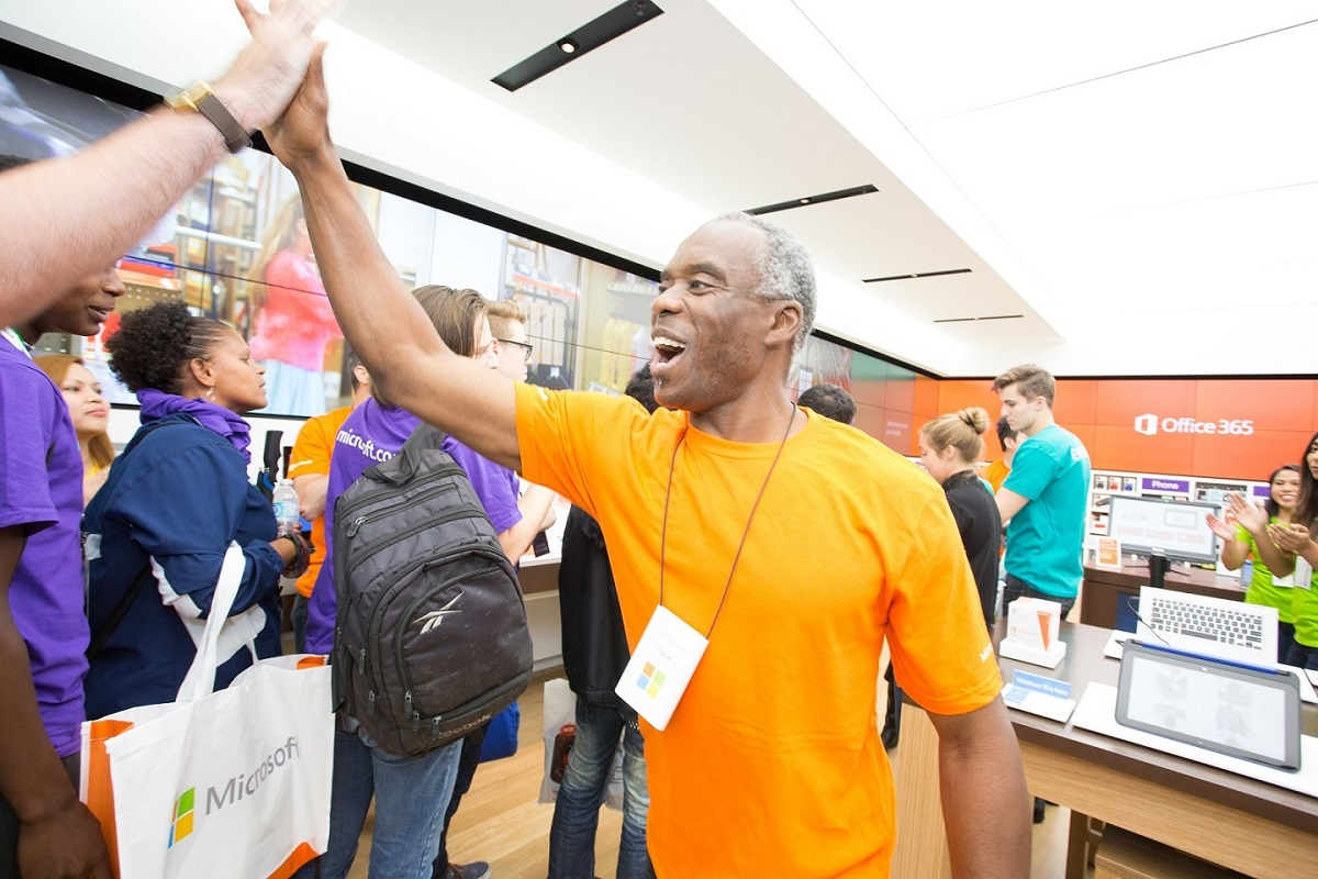 Microsoft Store employee gives a customer high five