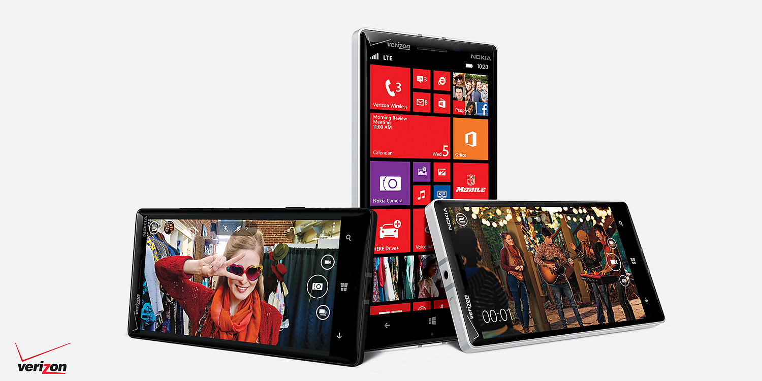 Three Lumia icon phones placed in various position showing photo ...