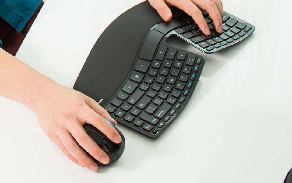 Hands on a keyboard and mouse