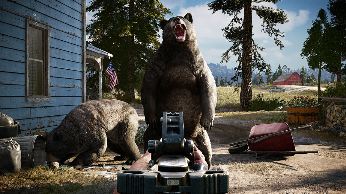 Man aims his gun at a bear roaring at him.