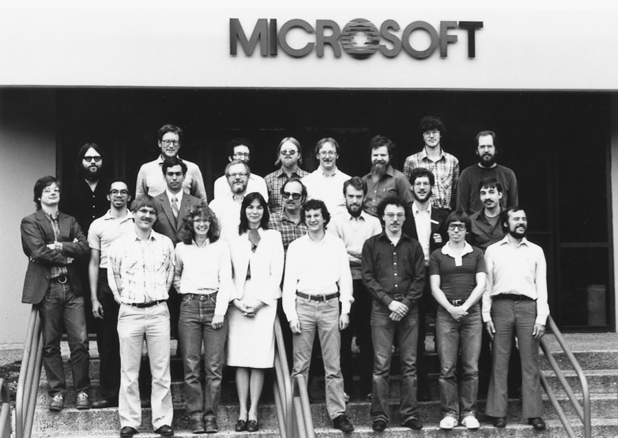 Windows team standing on a staircase outside Microsoft office